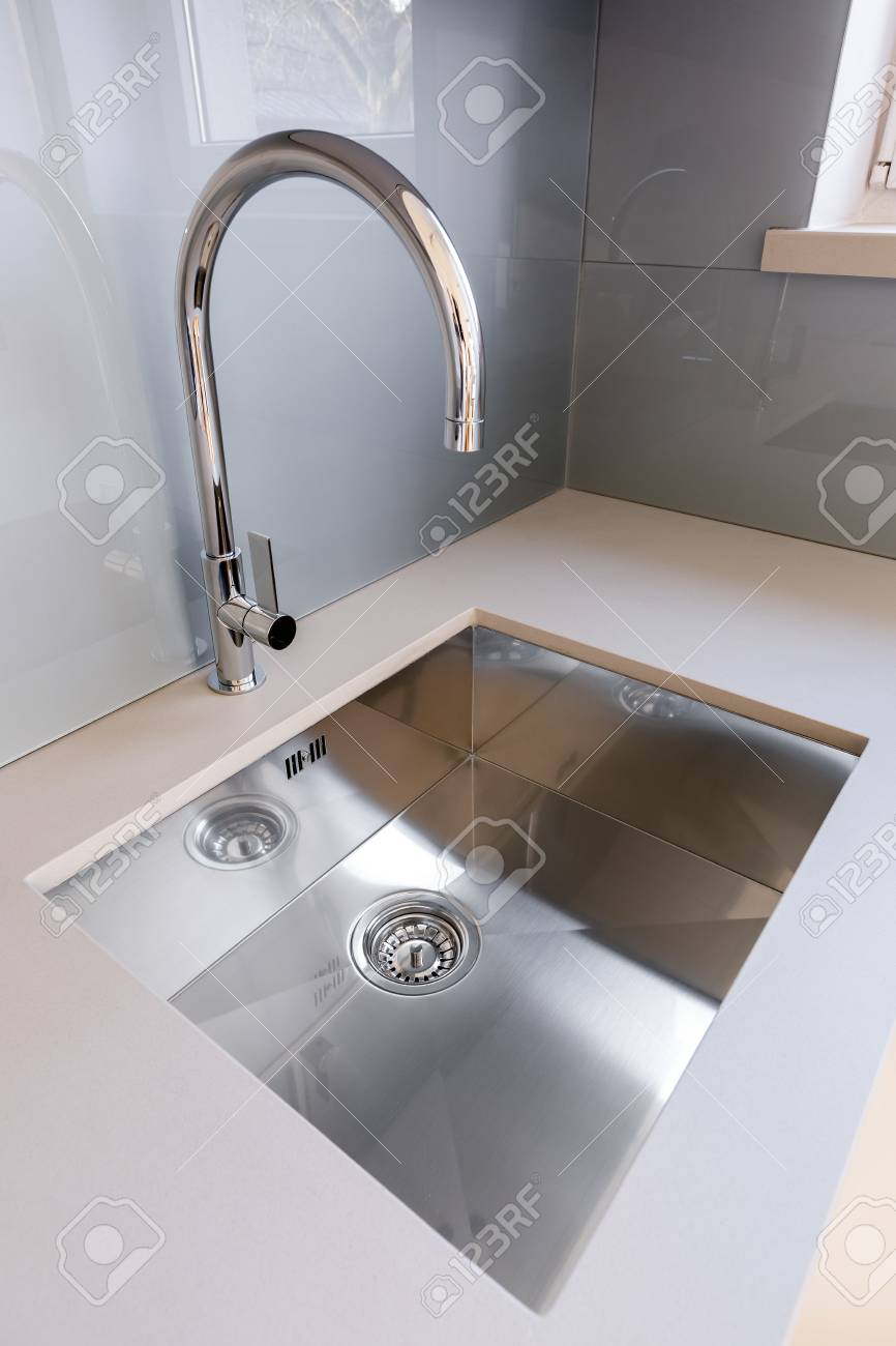 Silver Kitchen Sink Gray Wall Tiles And Countertop Stock Photo Picture And Royalty Free Image Image 86369690