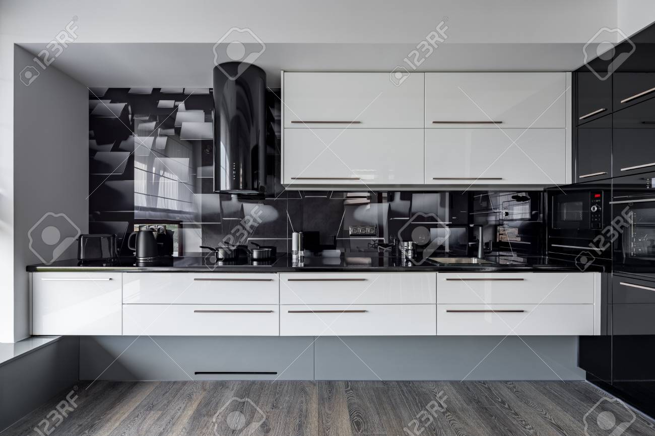 Modern Kitchen With White Cupboards And Black Wall Tiles Stock Photo Picture And Royalty Free Image Image 87488826