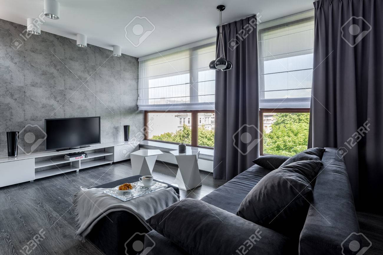 Modern tv living room with couch, new design coffee table and big windows - 87488827