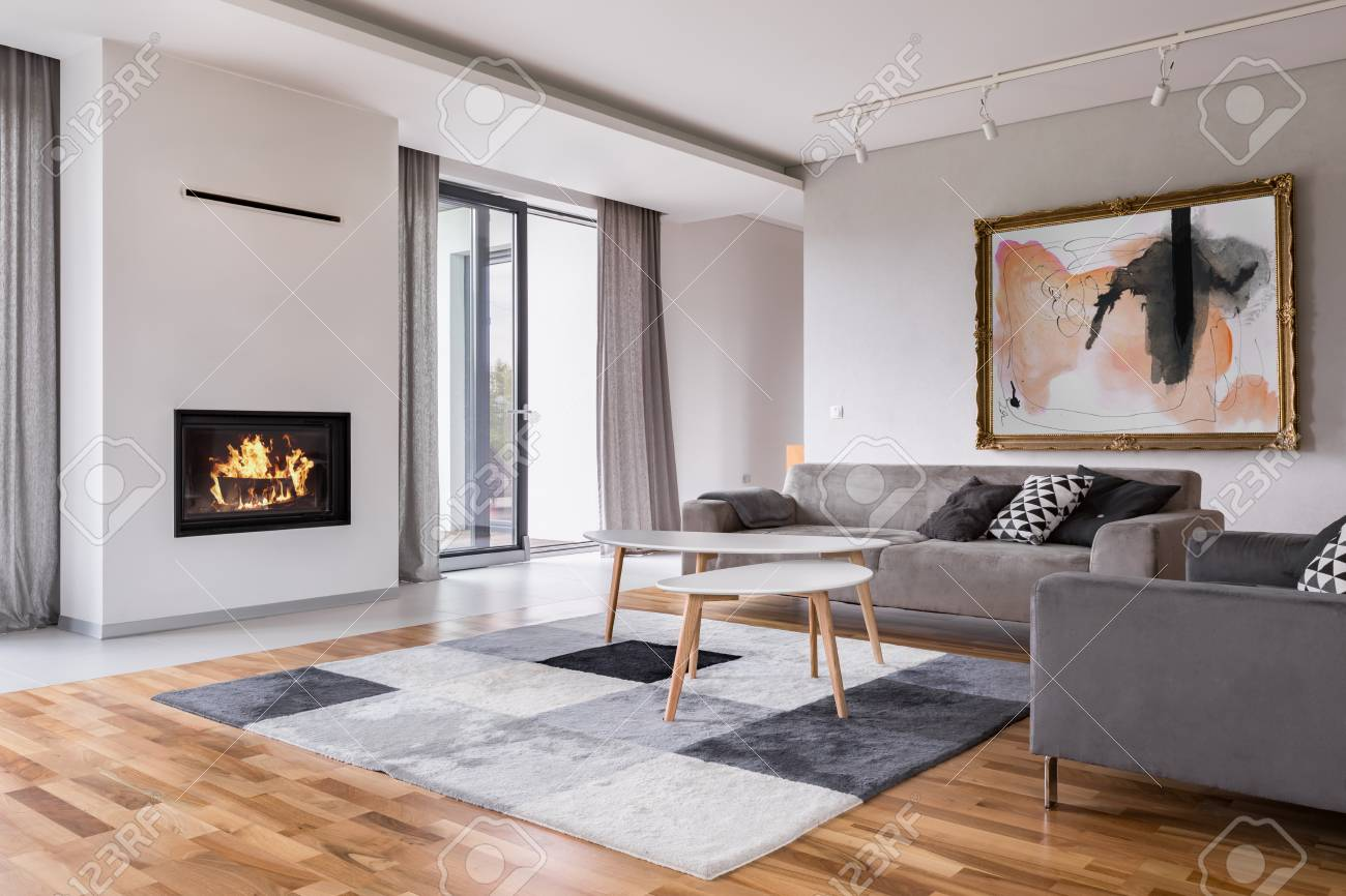 Modern living room with fireplace, sofa, balcony and pattern..