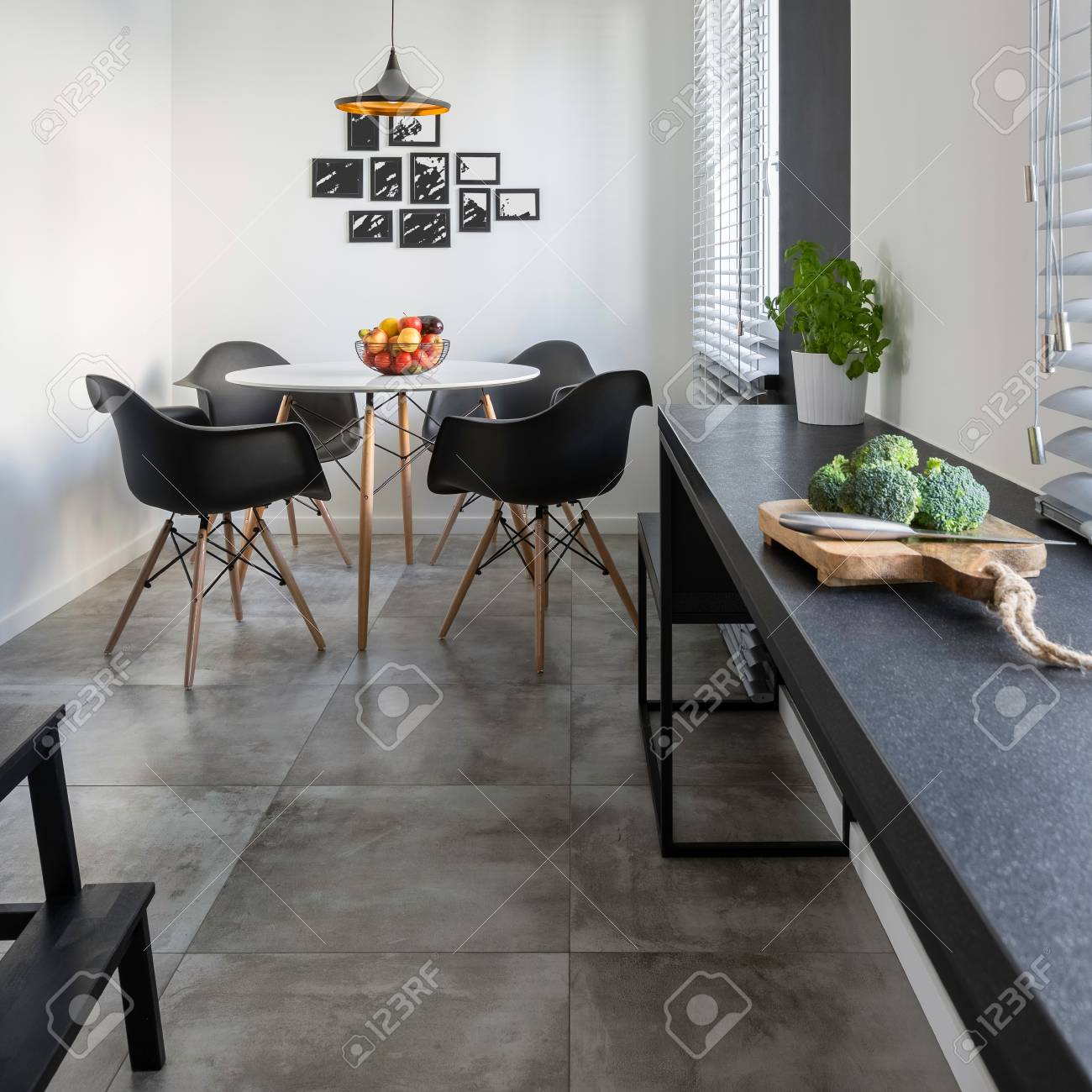 Kitchen With Long, Granite Countertop, Concrete Floor Tiles And ...