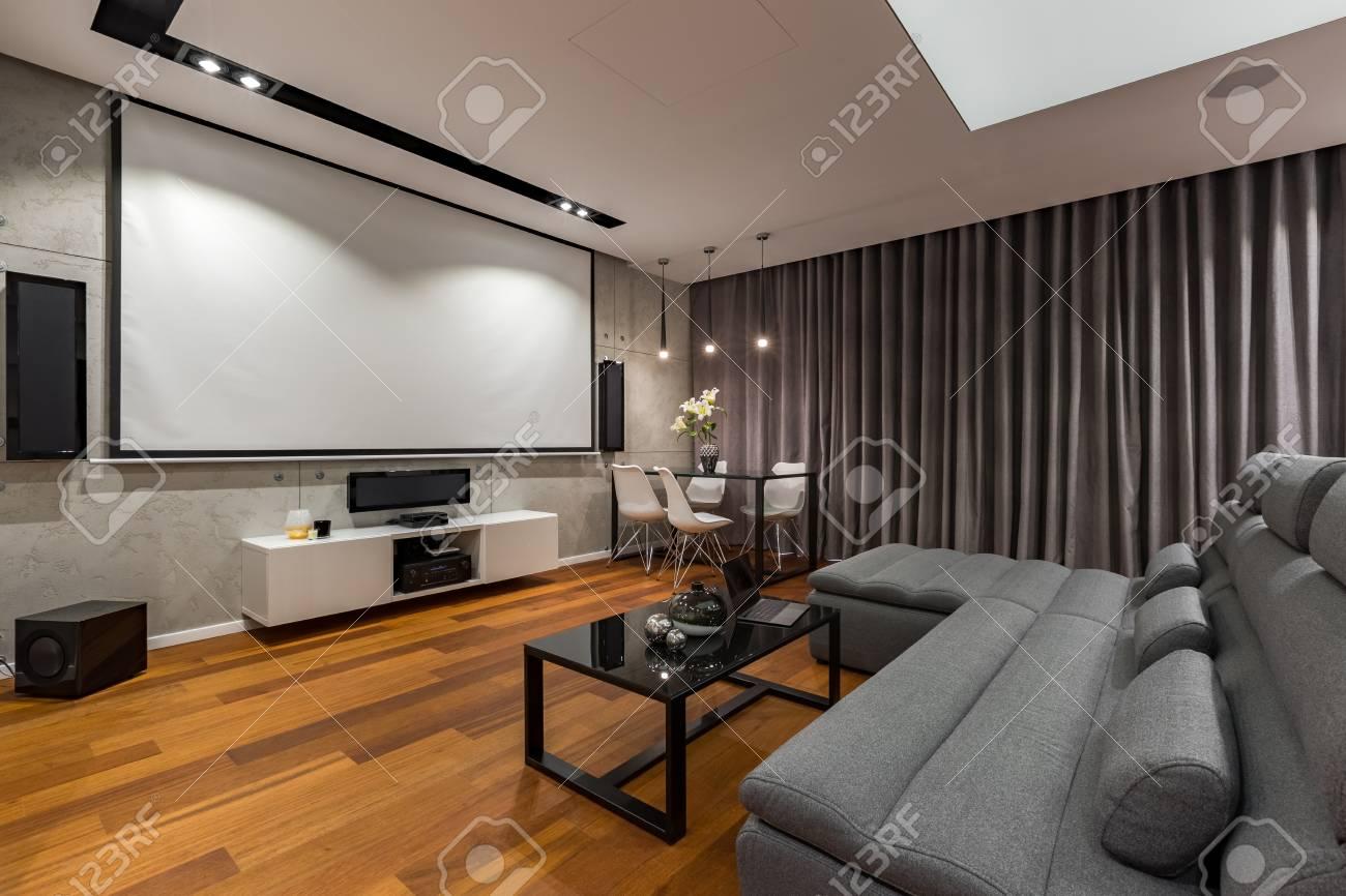 Living Room With Narrow Sofa Black Glass Coffee Table And