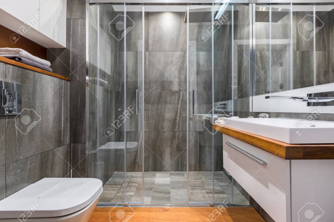 Gray Bathroom With White Cabinet Basin, Toilet And Elegant Walk ...
