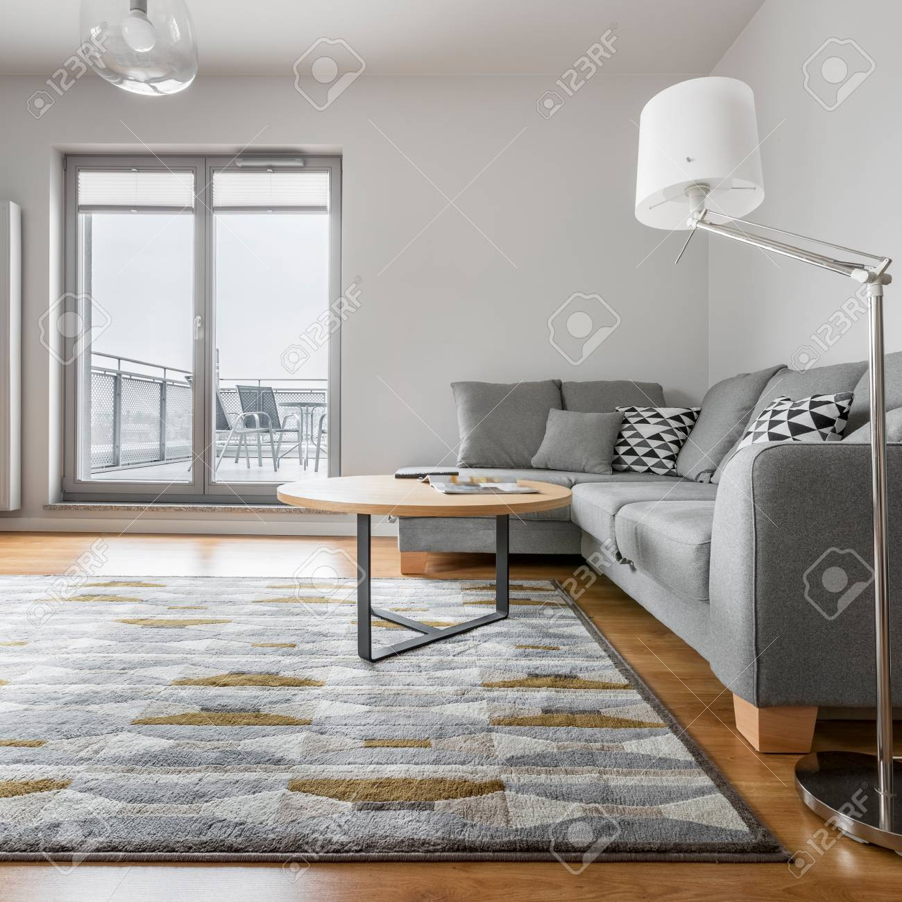 Grey And White Living Room With Sofa, Lamp, Carpet, Round Table ...