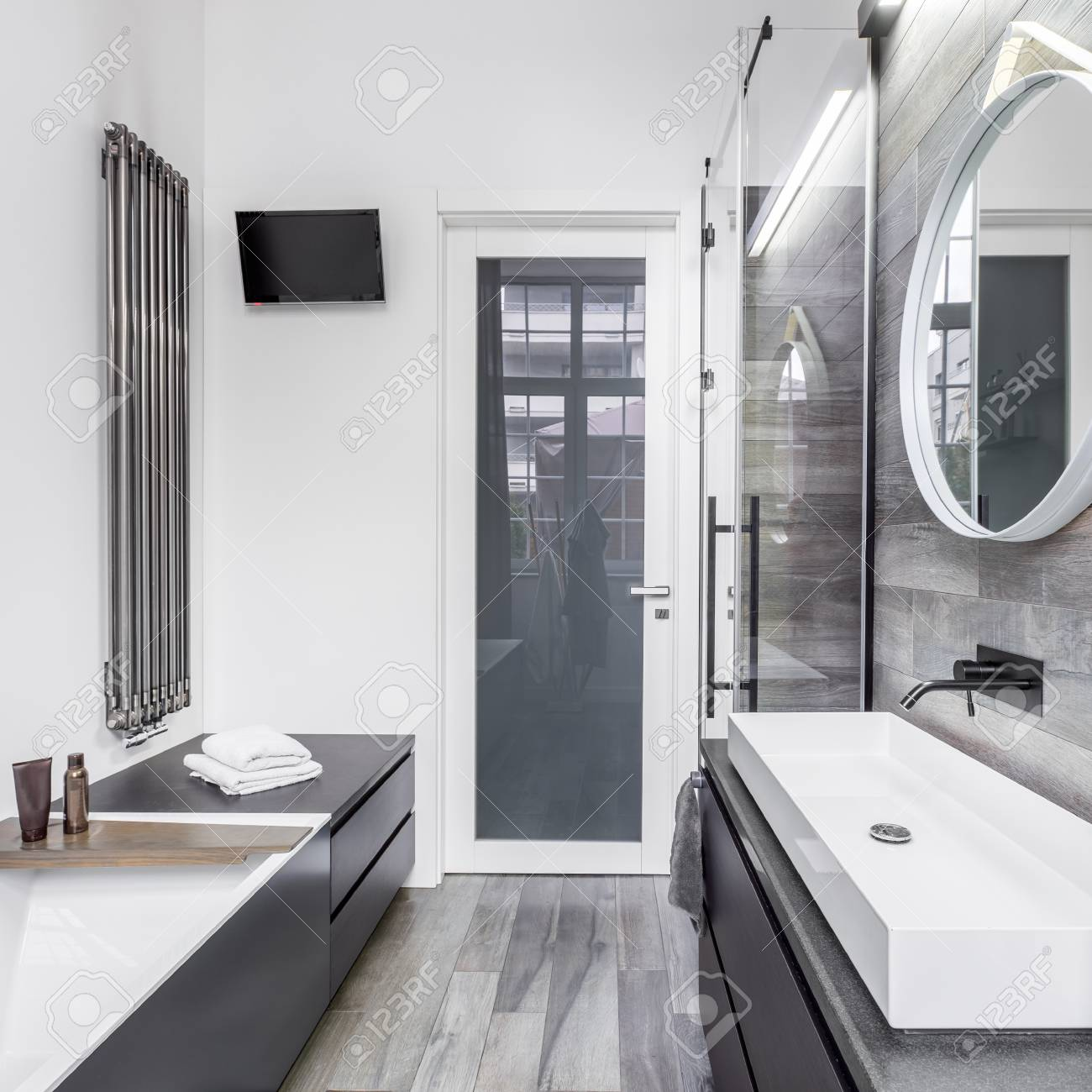 Elegant Design In Bathroom With White Walls And Wooden Tiles Stock ...