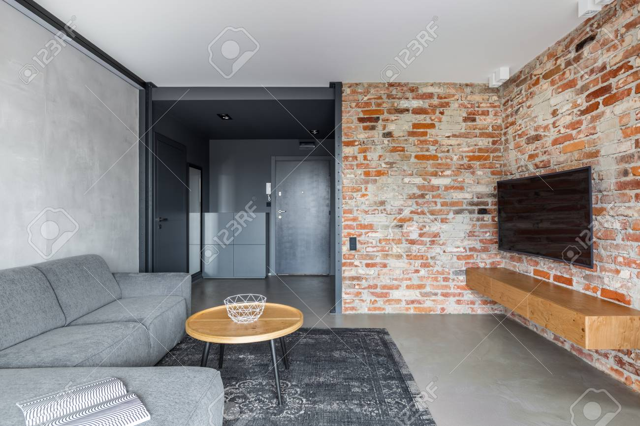 Exposed Brick Wall And Concrete Floor In Industrial Living Room Stock Photo    90735641