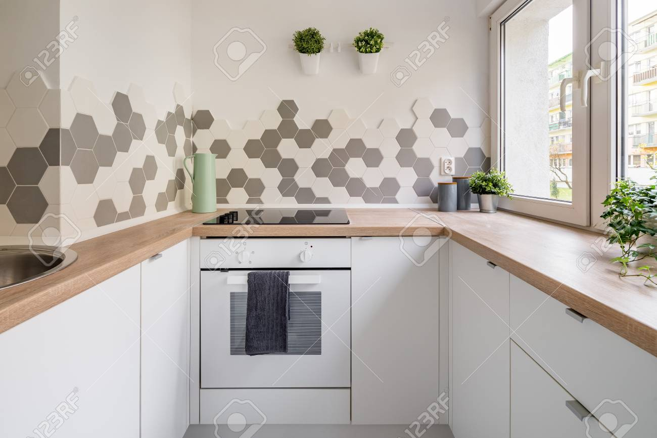 Wall Tiles For Kitchen | Kitchen In Scandinavian Style With White Cabinets Wooden Countertop