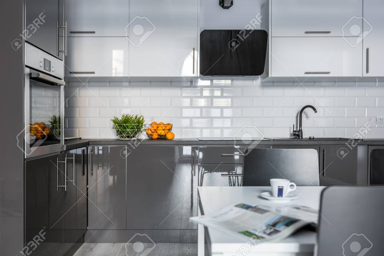 High Gloss White And Gray Cabinets In Modern Kitchen Stock Photo   92443659