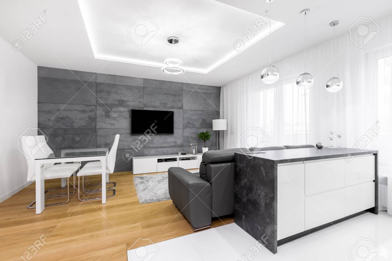 Open Living Room With Dining Space, Lounge Area And Kitchen Island ...