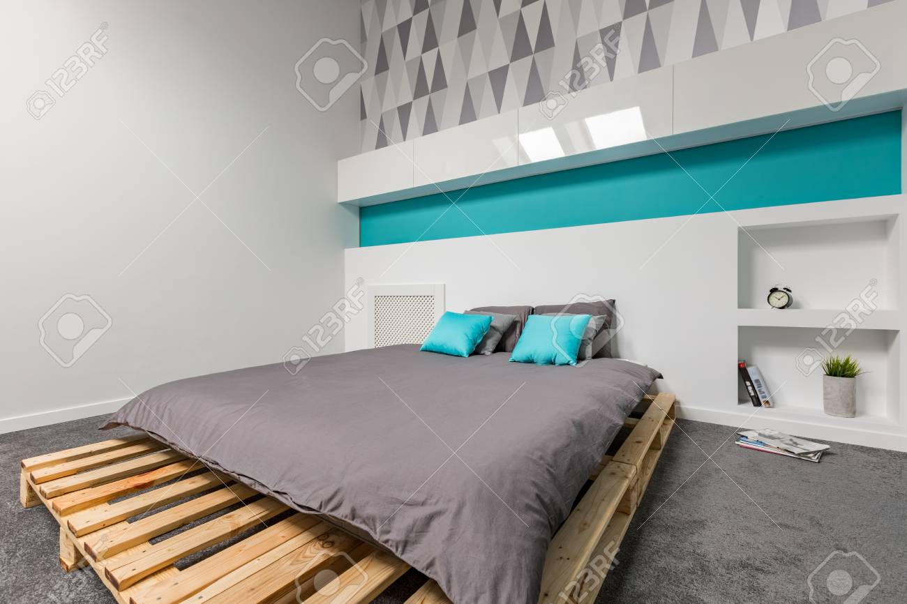 Simple And Modern Bedroom With Pallet Bed And Patterned Wallpaper Stock Photo Picture And Royalty Free Image Image 92822063