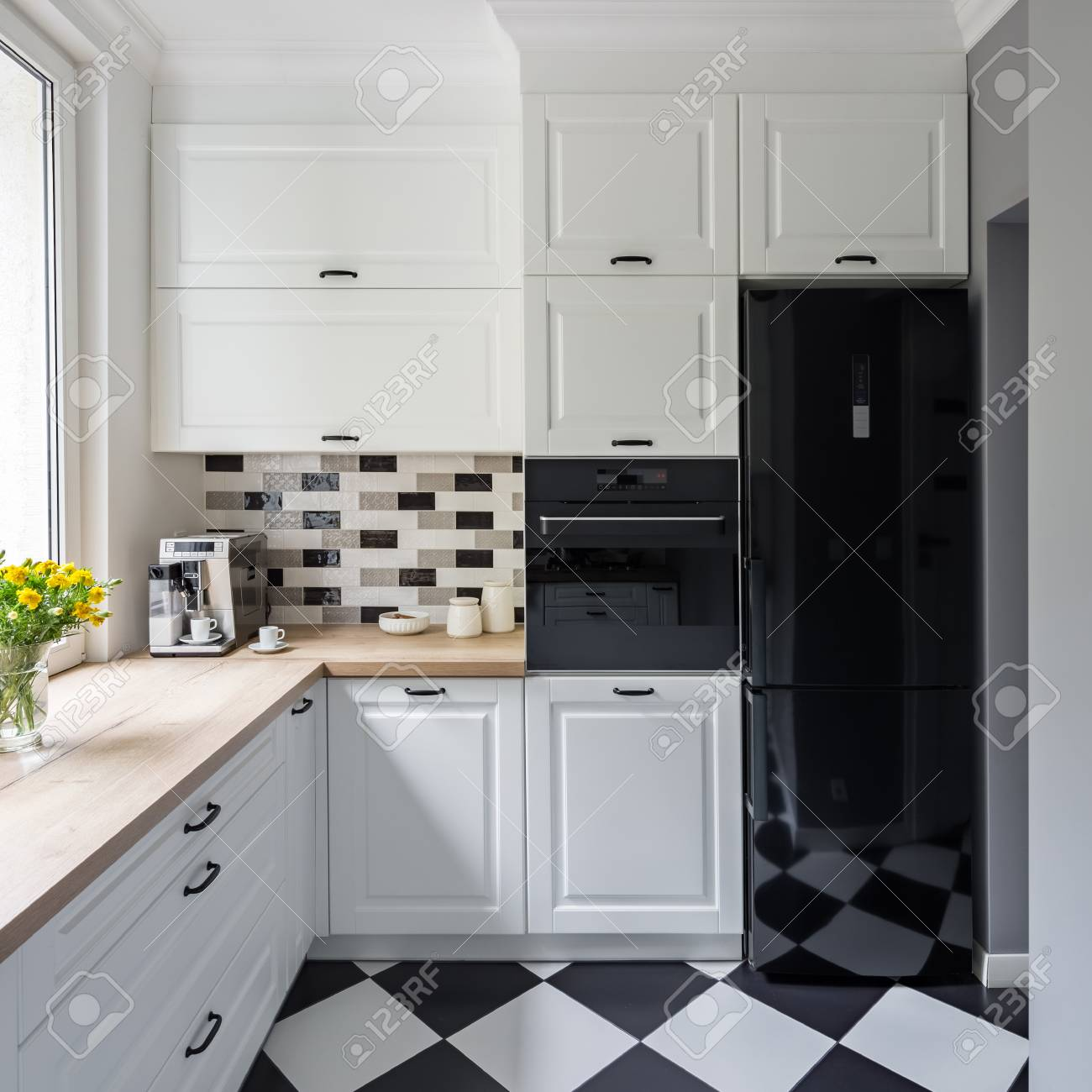 Small White Kitchen With Modern Chess Flooring And Black Fridge Stock Photo Picture Royalty Free Image 93738724