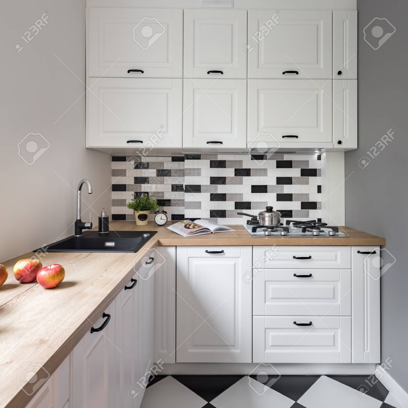 Small Kitchen With Classic White Furniture And Modern Tiles Stock Photo Picture And Royalty Free Image Image 93738729