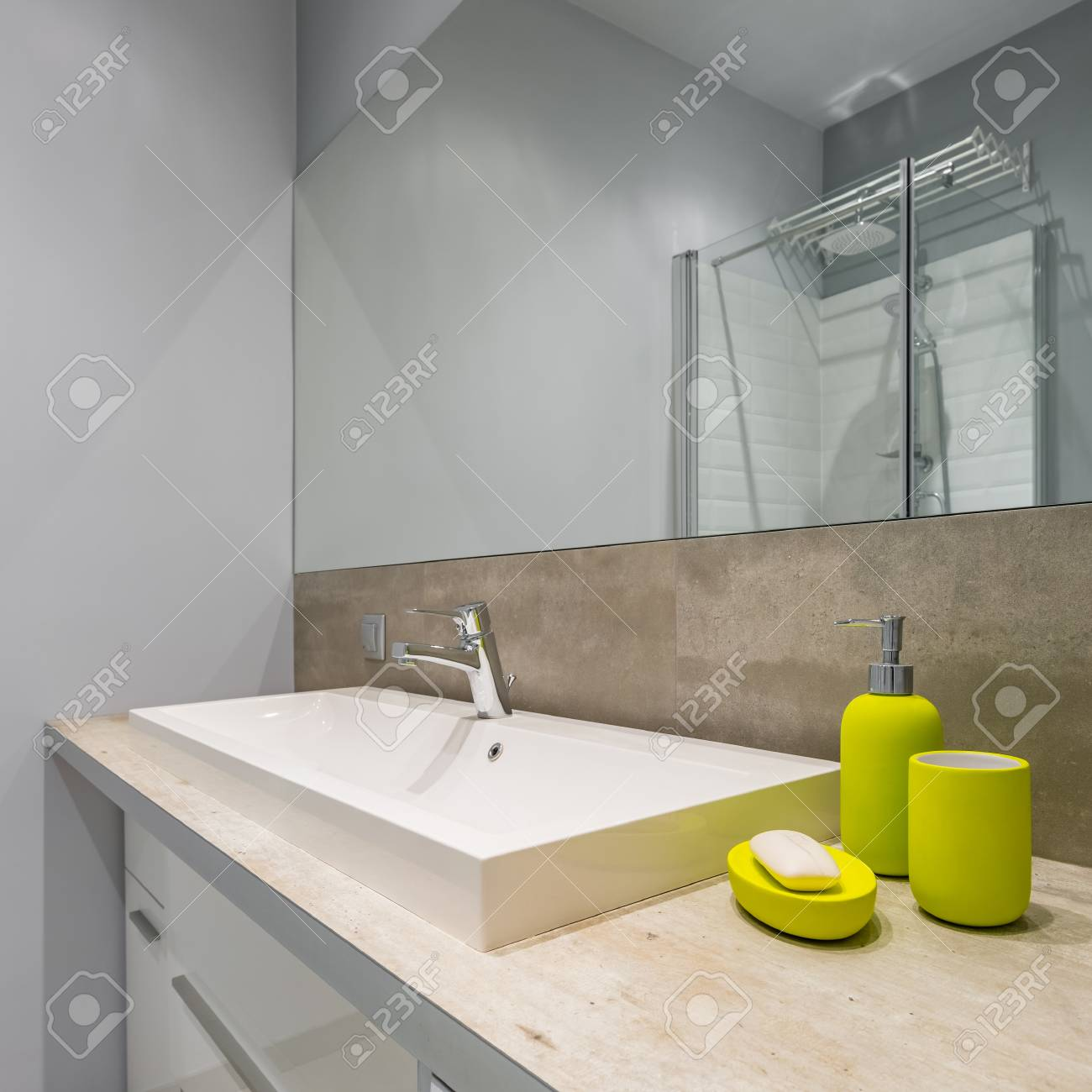 Modern Bathroom With Countertop Basin Big Mirror And Green Accessories Stock Photo Picture And Royalty Free Image Image 95593284