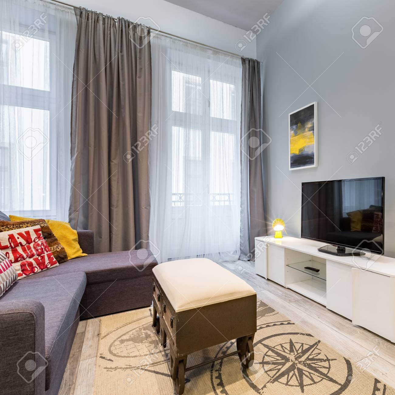 Contemporary Living Room With Tv Wheel Coffee Table And Sofa