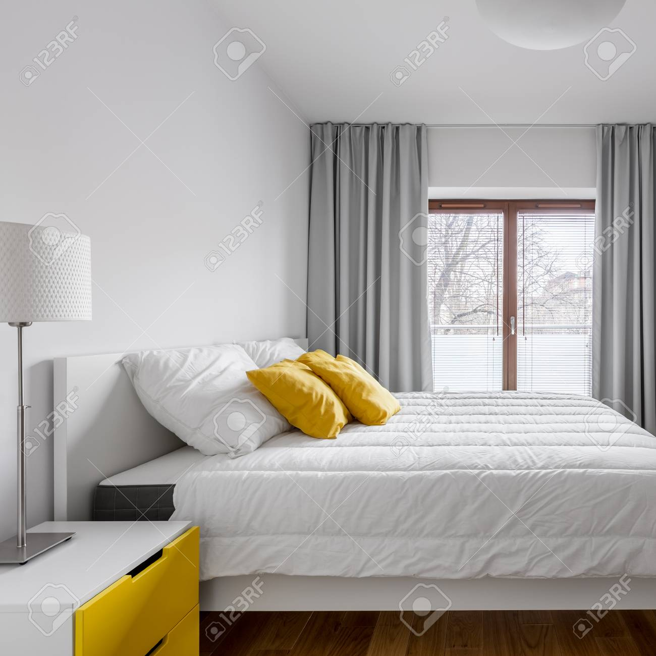 White Bedroom With Double Bed Window Gray Curtains Lamp And Stock Photo Picture And Royalty Free Image Image 95877024