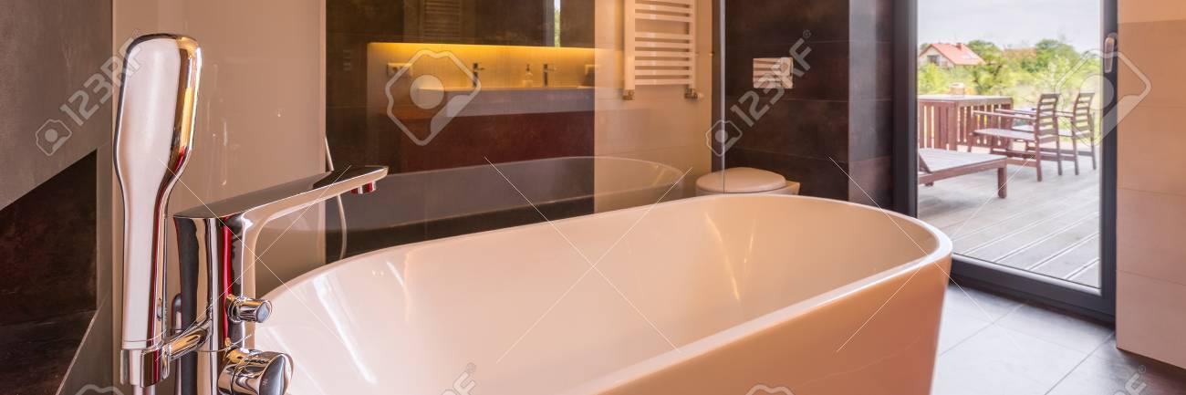 Luxurious Bathroom With Stylish Bathtub And Big Window, Panorama ...