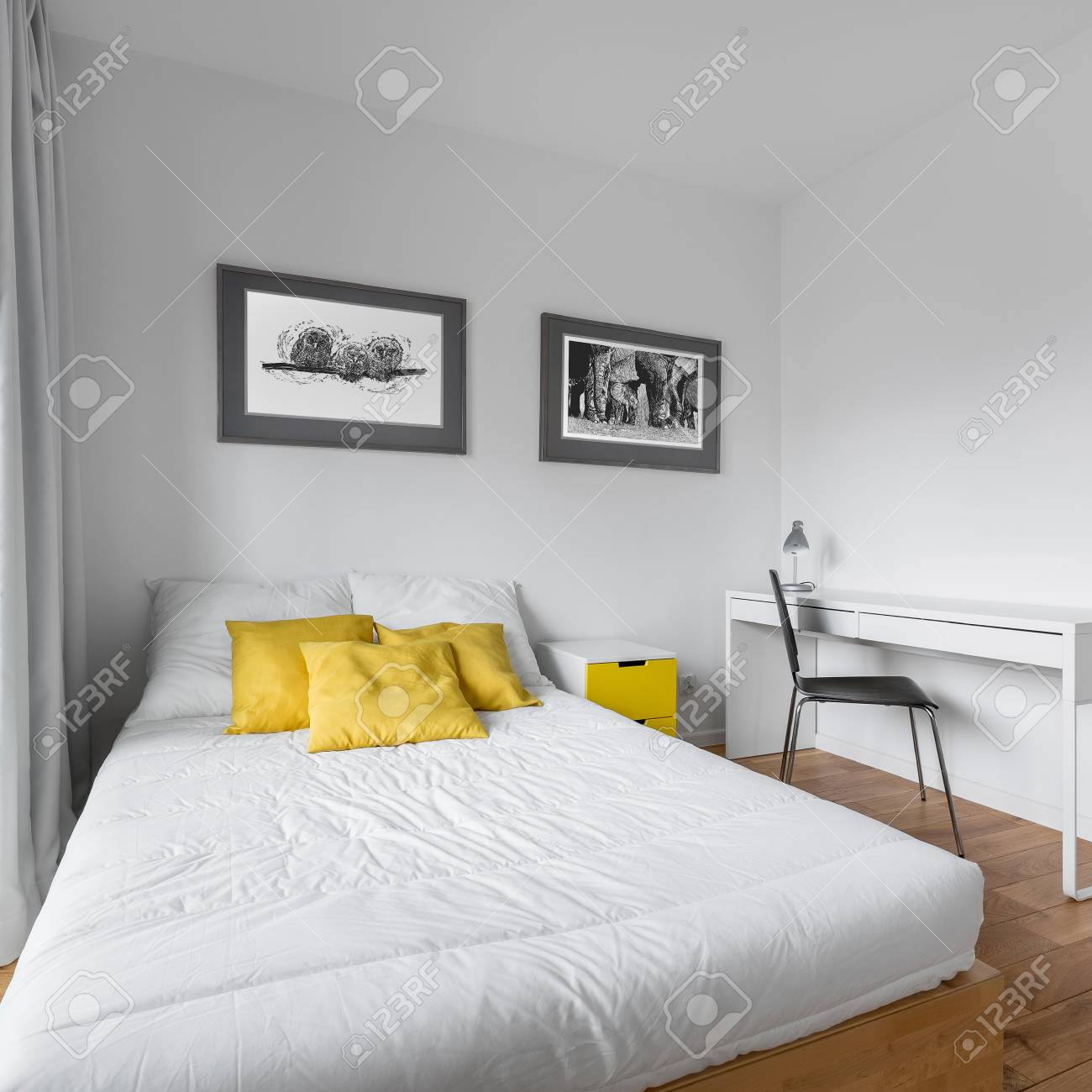 Cozy White Bedroom With Big Twin Size Bed And Yellow Accessories Stock Photo Picture And Royalty Free Image Image 96855841