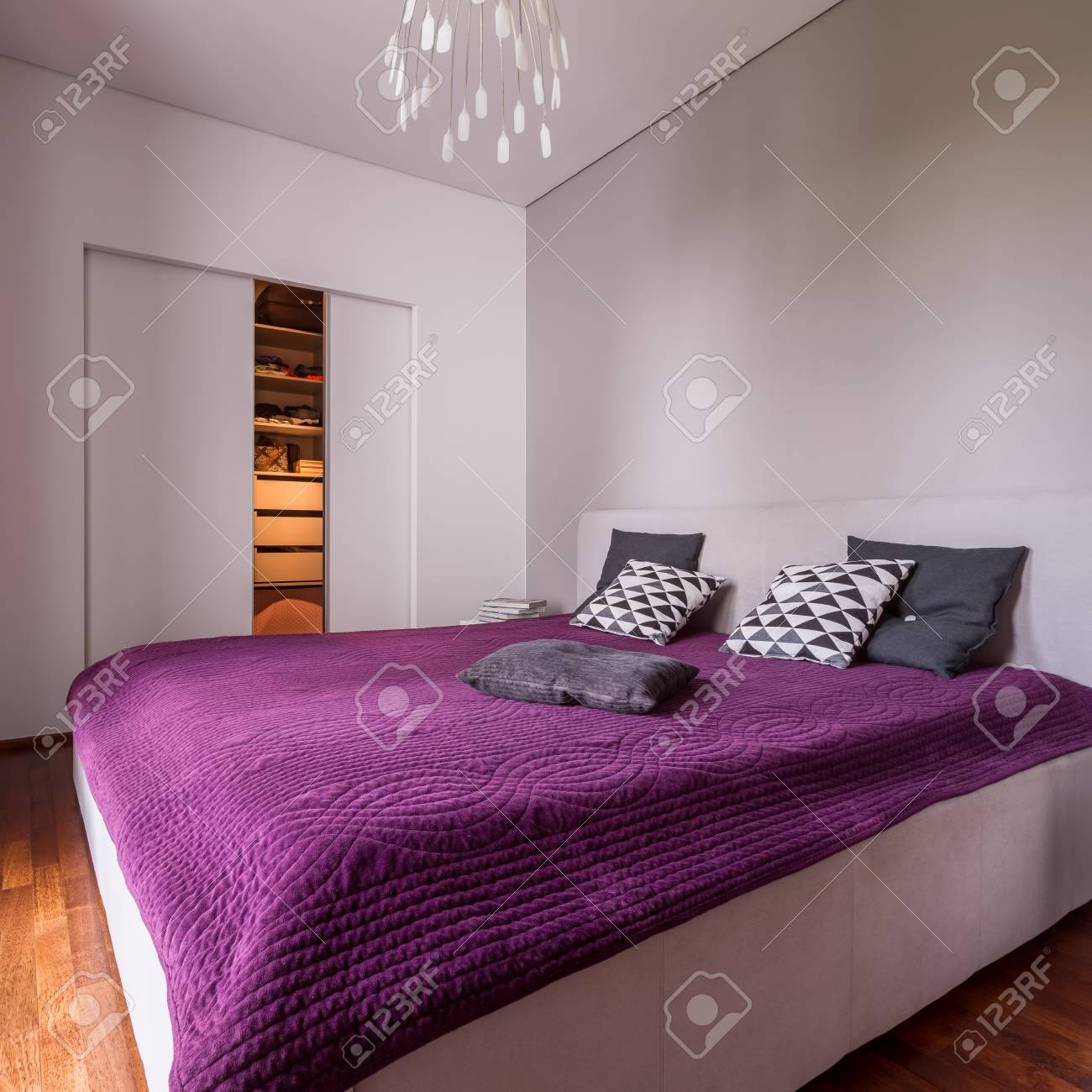 Modern Bedroom With Double Bed And Sliding Door Wardrobe Stock Photo