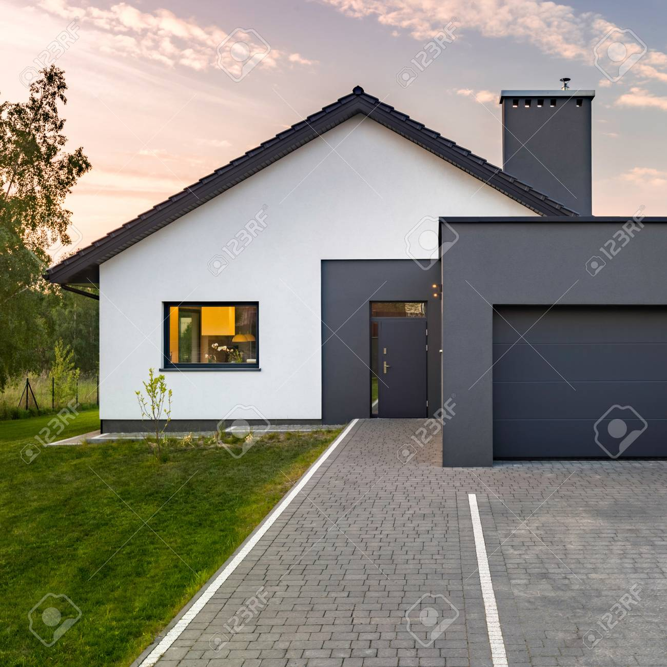 Square frame of modern house with garage and green lawn stock photo 98909551