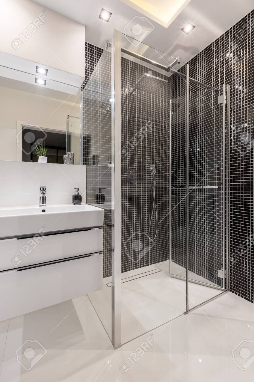 Bathroom With Walk In Shower Black Mosaic Tiles And Cabinet
