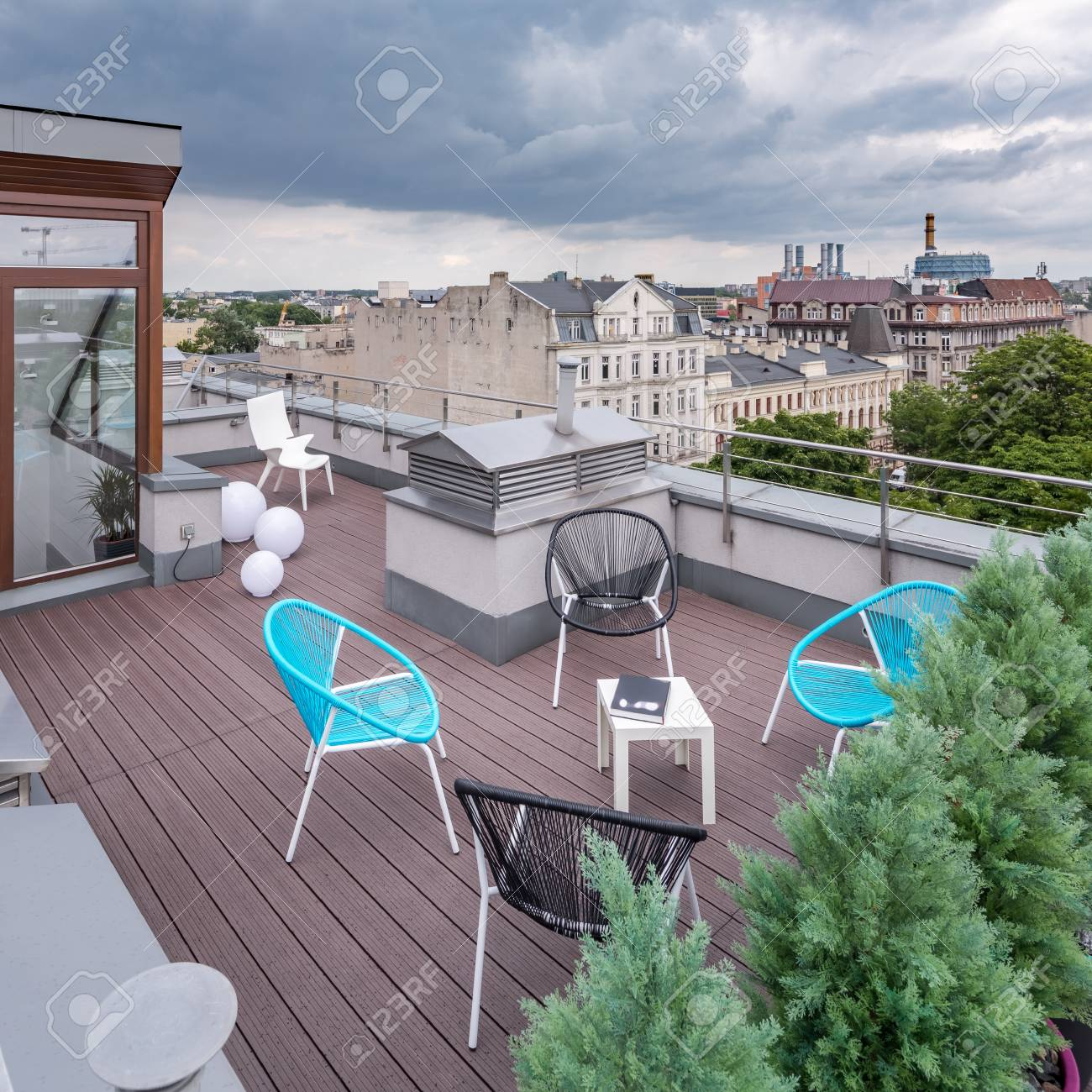 Beautiful rooftop patio with new design chairs and small table city view Stock Photo - & Beautiful Rooftop Patio With New Design Chairs And Small Table ...
