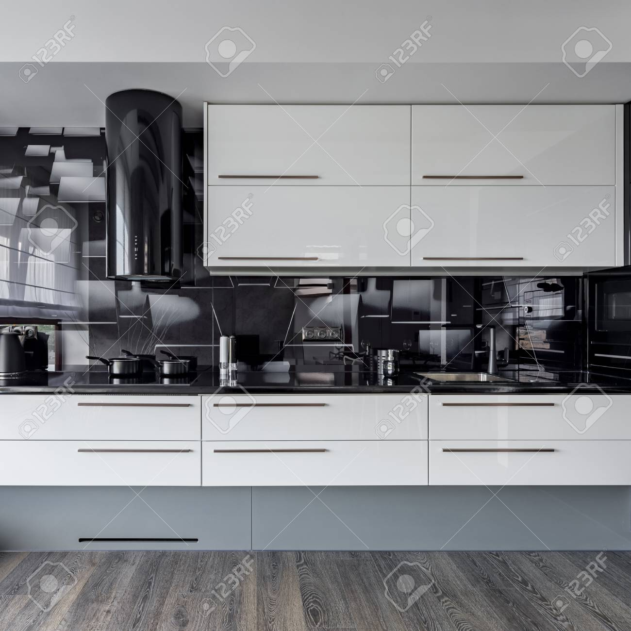Modern Kitchen With White Cupboards And Black Wall Tiles Stock Photo Picture And Royalty Free Image Image 105231120