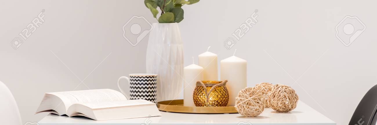 Decorative Home Accessories In Scandinavian Style Lying On White Table Panorama Stock Photo