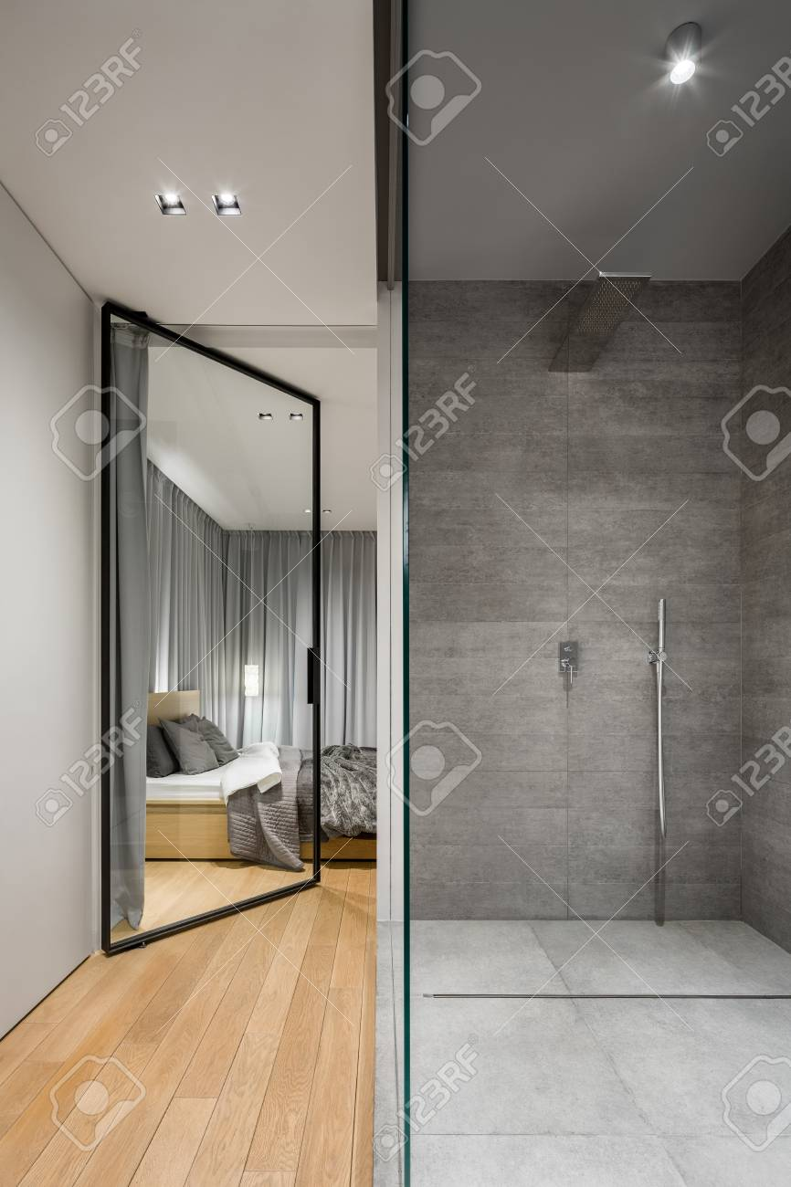 Modern Bathroom With Spacious Walk In Shower Next To Bedroom