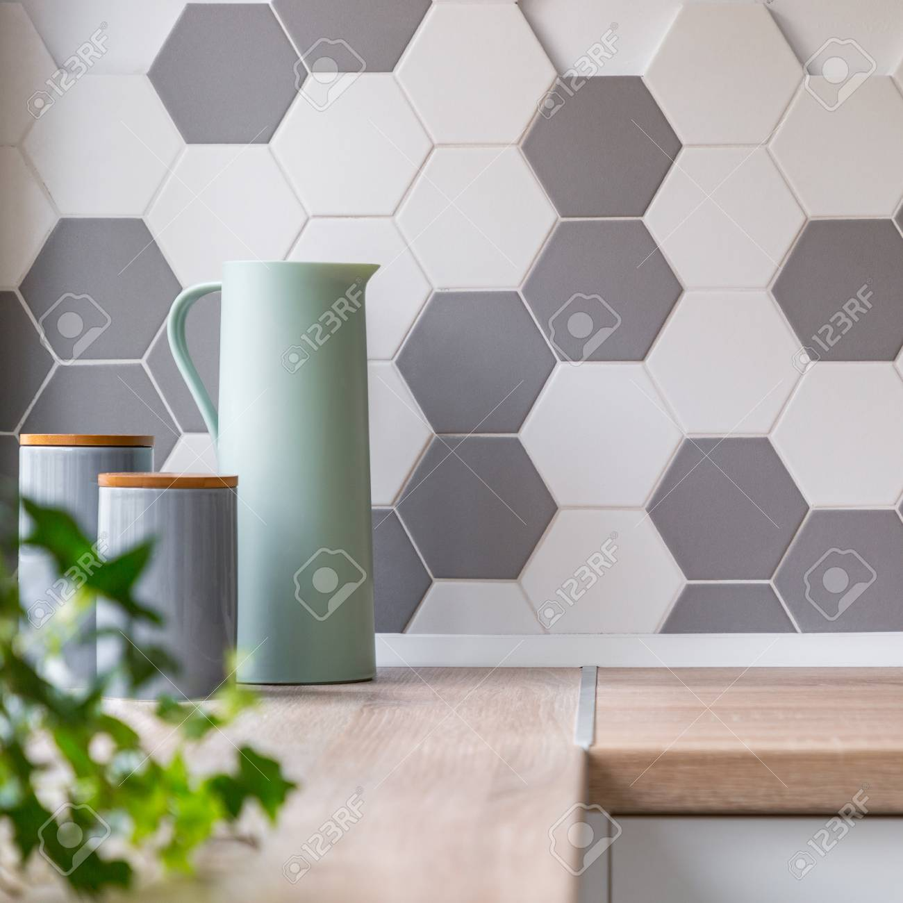 - Kitchen With Honeycomb White And Grey Wall Tiles, Wooden Worktop