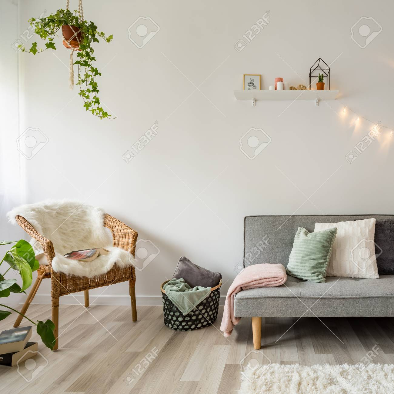 Gray Sofa Coffee Table And Wicker Chair In Scandinavian Style Stock Photo Picture And Royalty Free Image Image 105300214