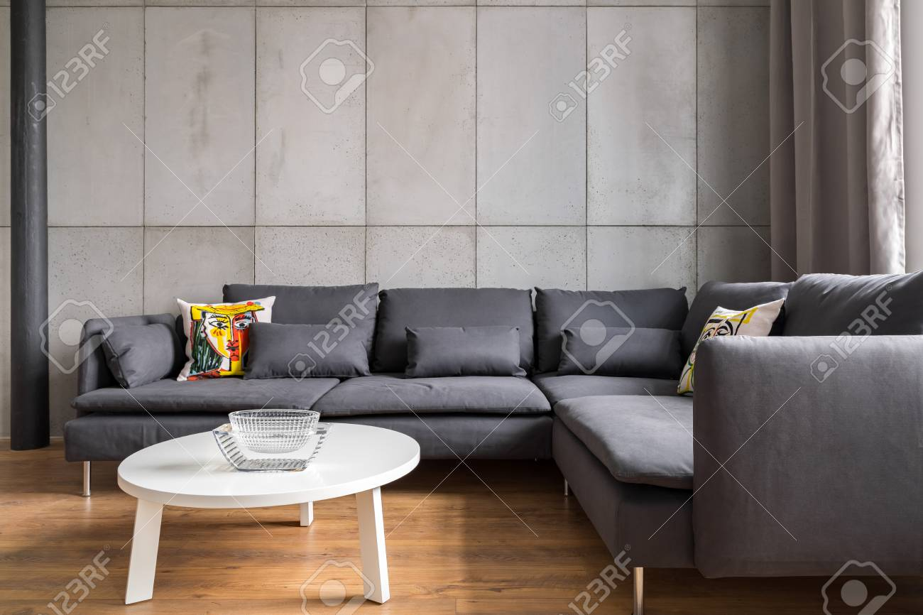 Home Interior With Modern Concrete Wall, Big Corner Sofa And.. Stock ...