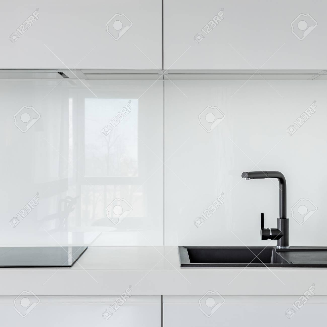 Kitchen With White Cabinets Countertop And Black Composite Stock Photo Picture Royalty Free Image 107812393
