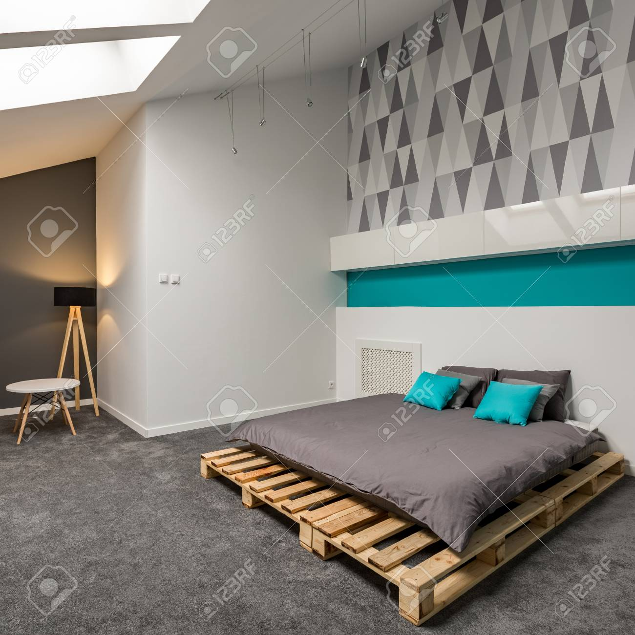 Grey And White Bedroom With Simple Pallet Bed And Patterned Wallpaper Stock Photo Picture And Royalty Free Image Image 108036591