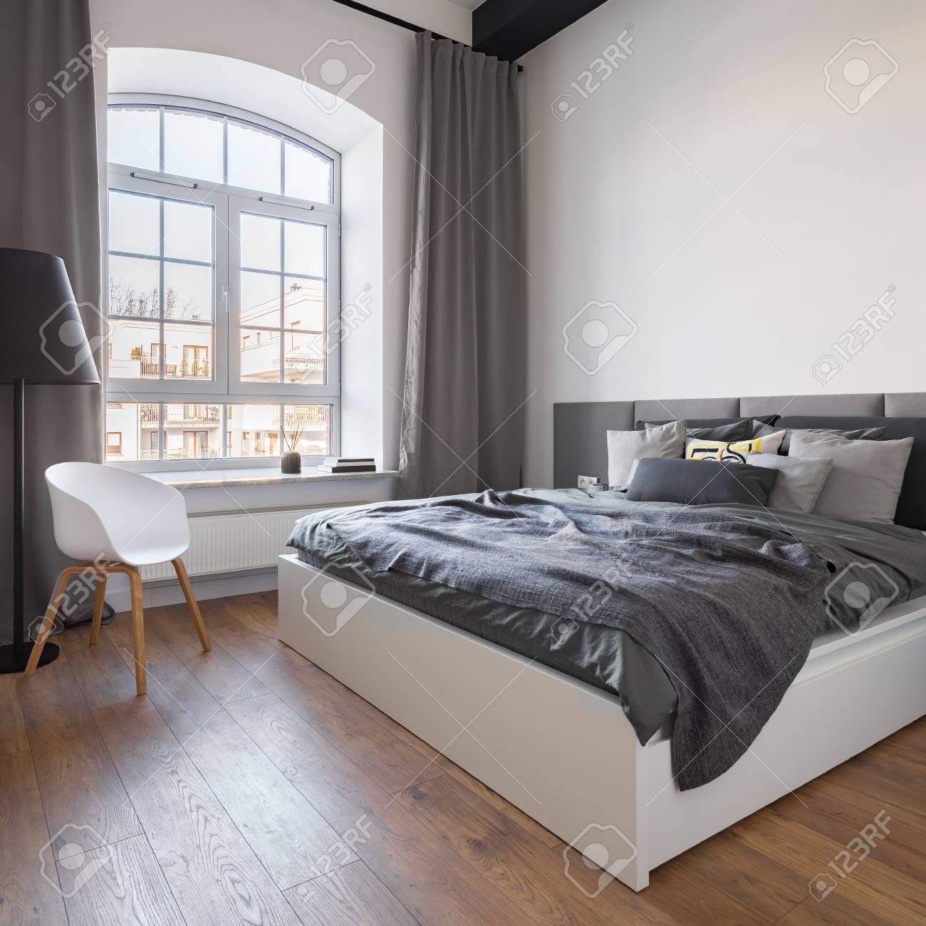 Gray Bedroom With Big Window, Double Bed And White Chair In ...