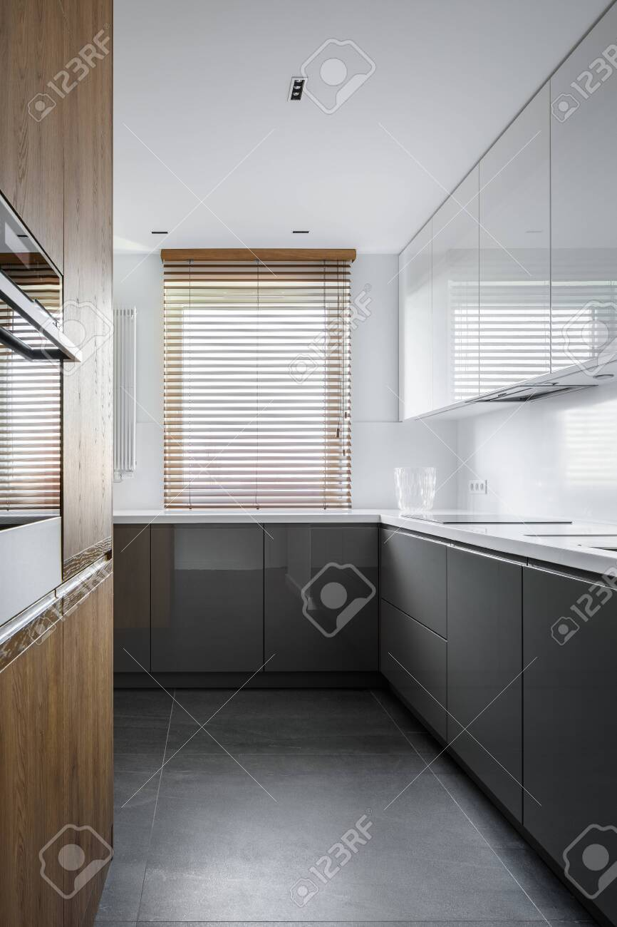 Simple And Elegant Kitchen With Wooden Blinds And Wall And Gray Stock Photo Picture And Royalty Free Image Image 119653419