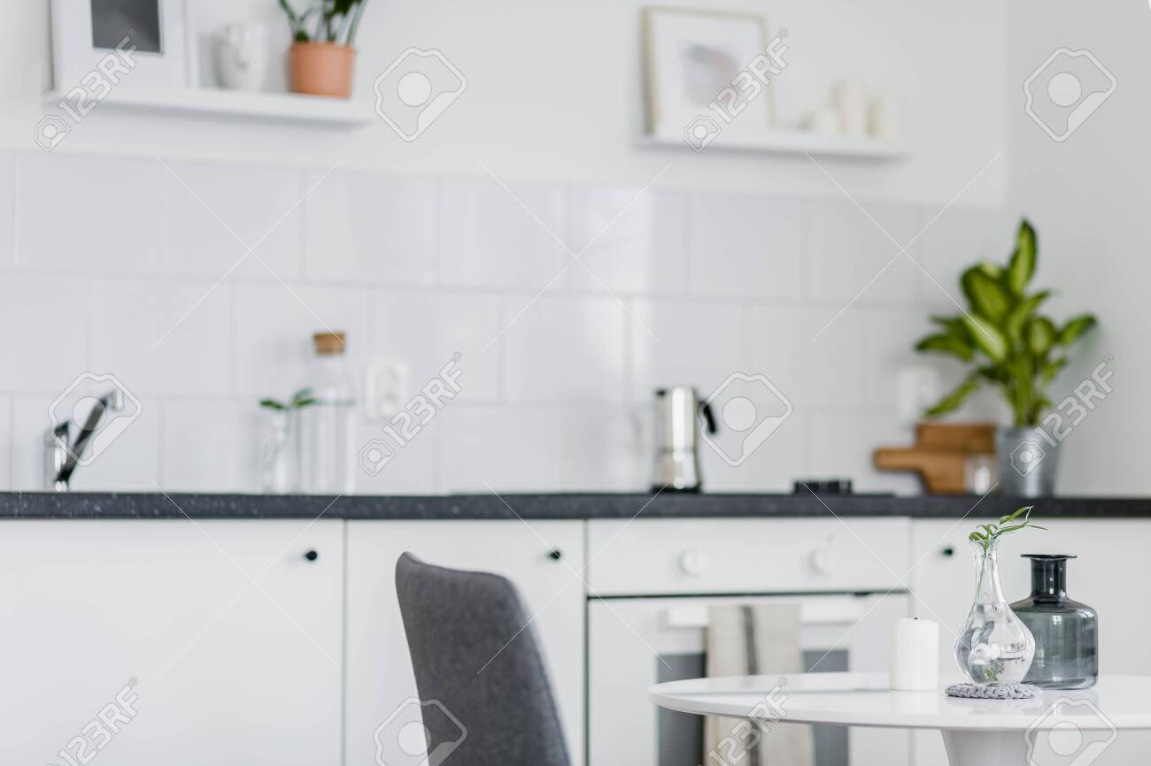 Small Round Dining Table Standing In A White Kitchen Stock Photo Picture And Royalty Free Image Image 120126778