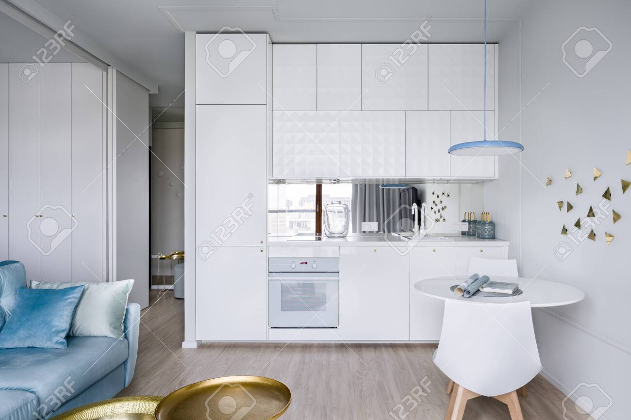 Contemporary Apartment Interior With Small Modern And White Kitchenette Stock Photo Picture And Royalty Free Image Image 121104763