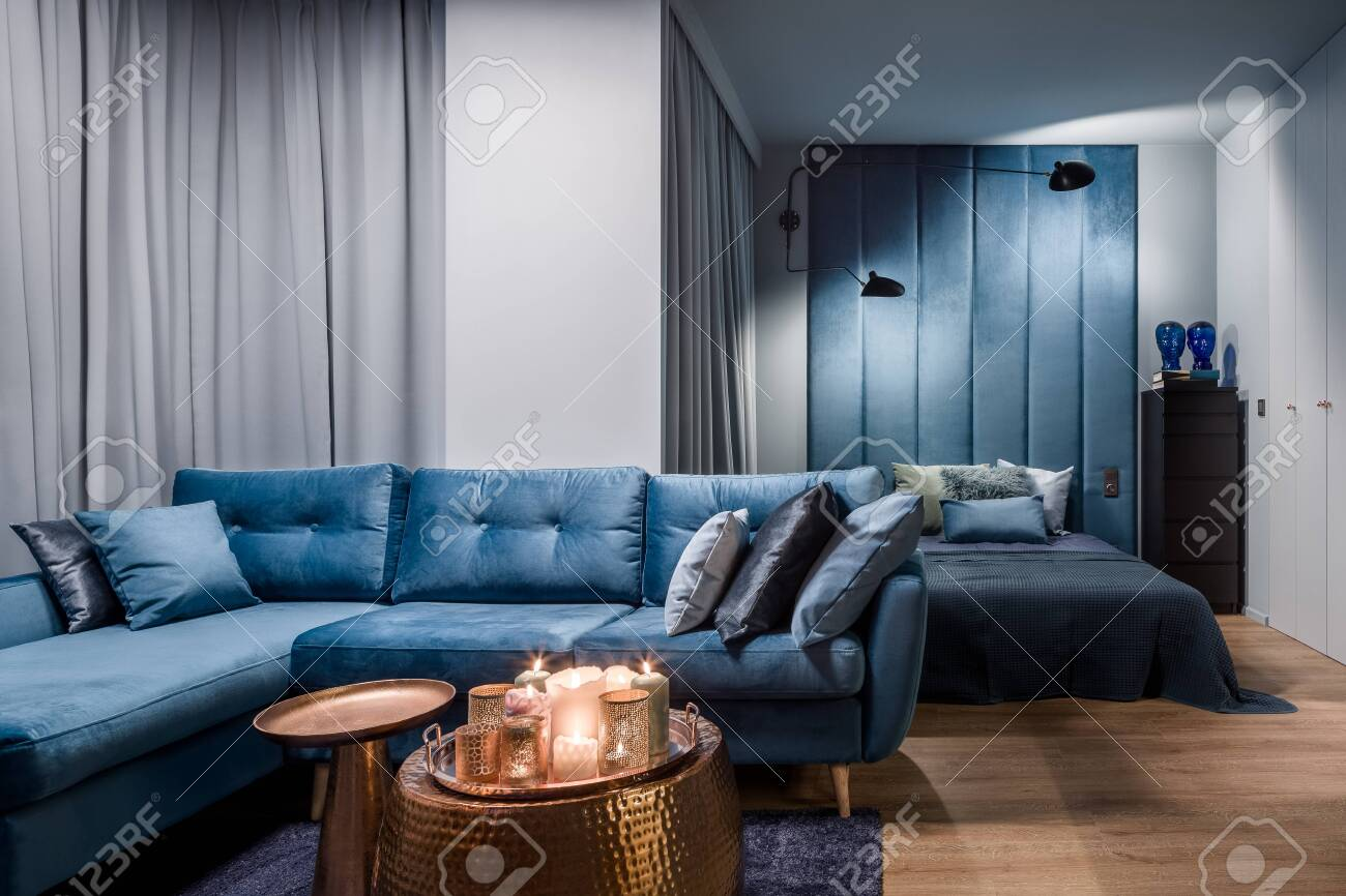 Amazing Apartment In Blue With Corner Sofa Copper Coffee Tables