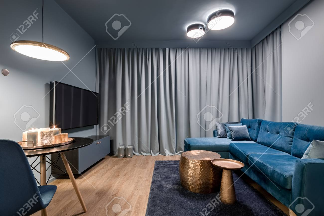 Elegant Living Room With Big Blue Sofa Two Copper Coffee Tables