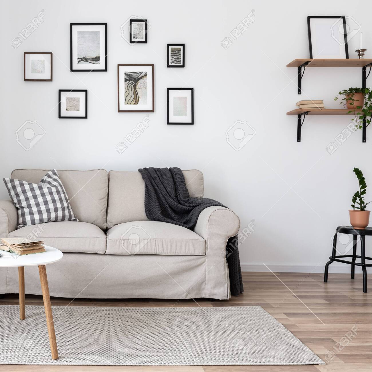 Simple Living Room With Wall Frames Sofa And Coffee Table Stock Photo Picture And Royalty Free Image Image 128416122