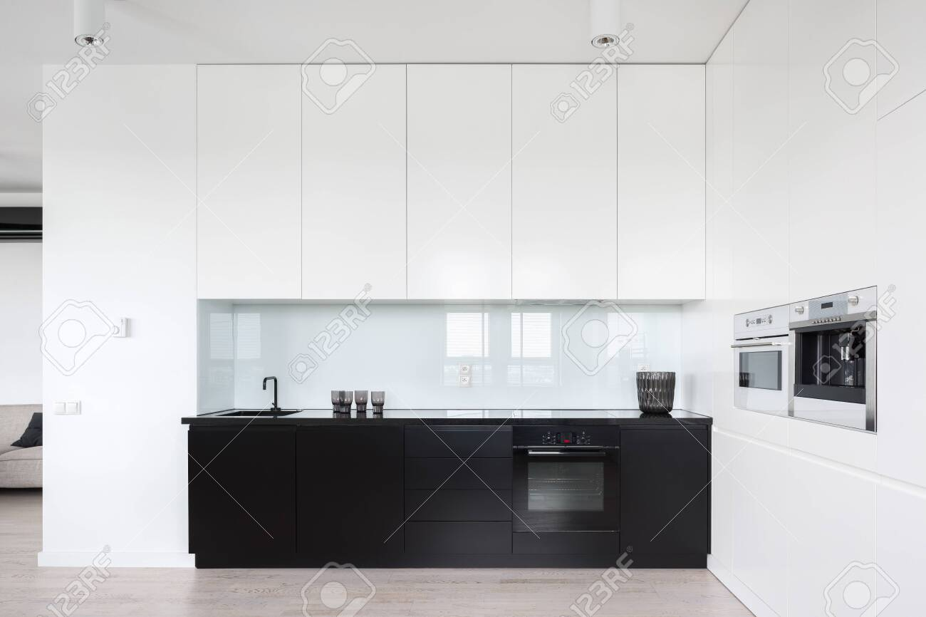 Modern And Simple Designed Kitchen Interior In Black And White Stock Photo Picture And Royalty Free Image Image 129440127