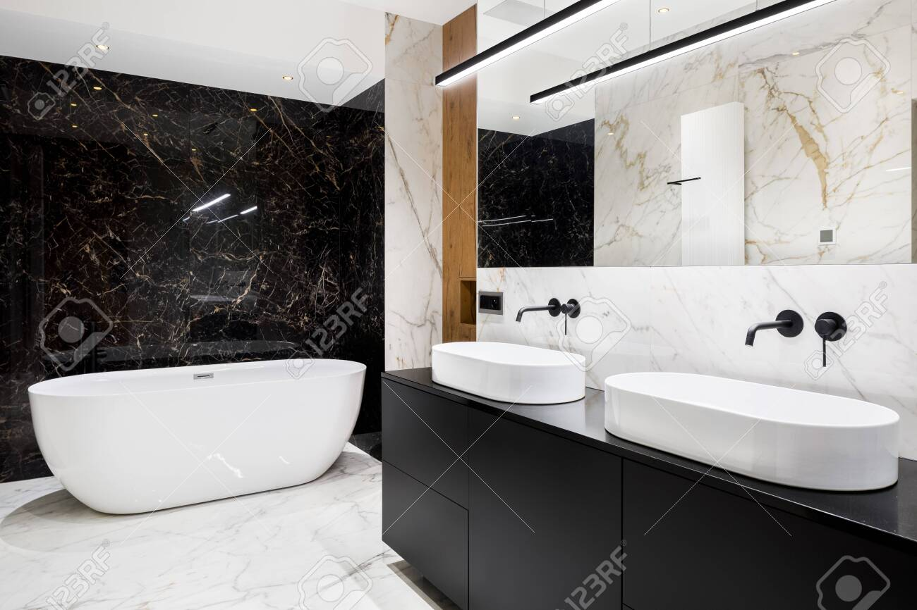 Luxury Bathroom With Black And White Marble Tiles On Walls And Stock Photo Picture And Royalty Free Image Image 143510910