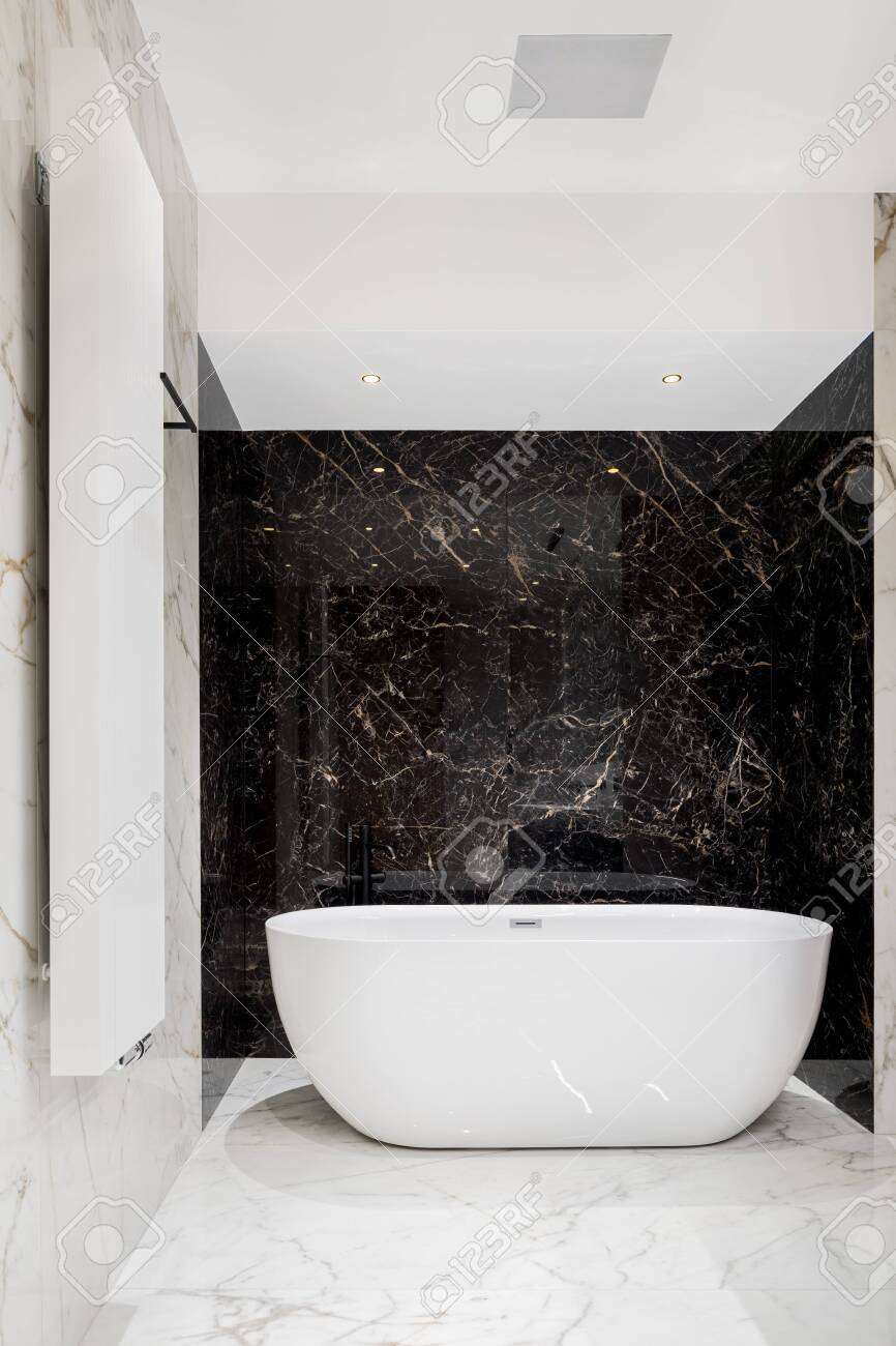 Luxury Big Oval Bathtub In Bathroom With Black And White Marble Stock Photo Picture And Royalty Free Image Image 143510918