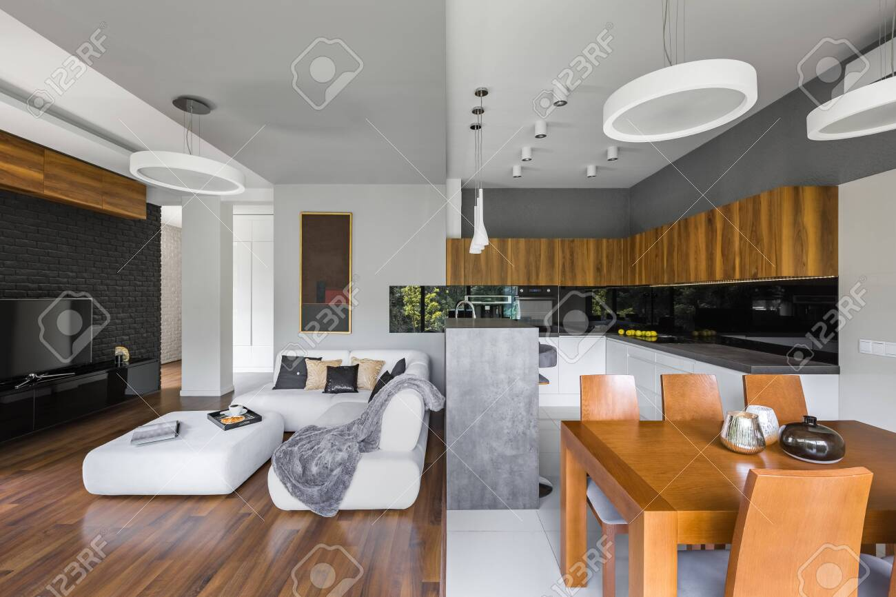 Elegant interior of living room with kitchen and dining area - 146770161
