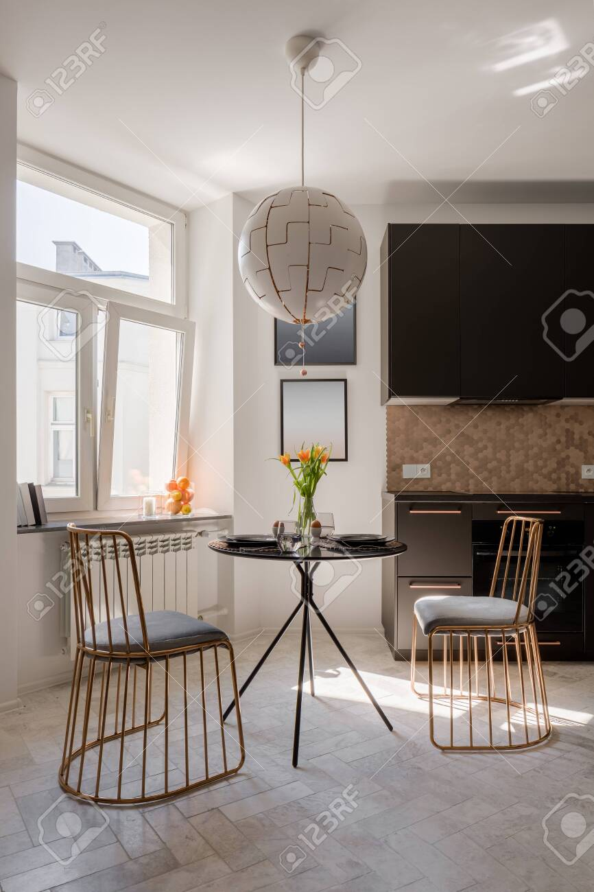 Small And Elegant Round Black Dining Table And Two Modern Designed Stock Photo Picture And Royalty Free Image Image 147767659