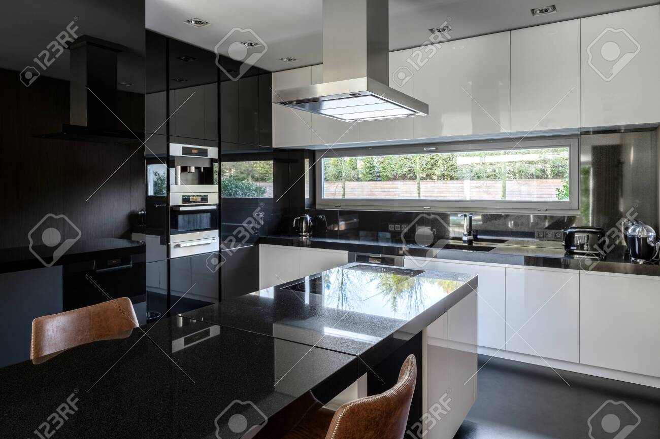 Modern Black And White Kitchen With Kitchen Island And Dining Stock Photo Picture And Royalty Free Image Image 148464502