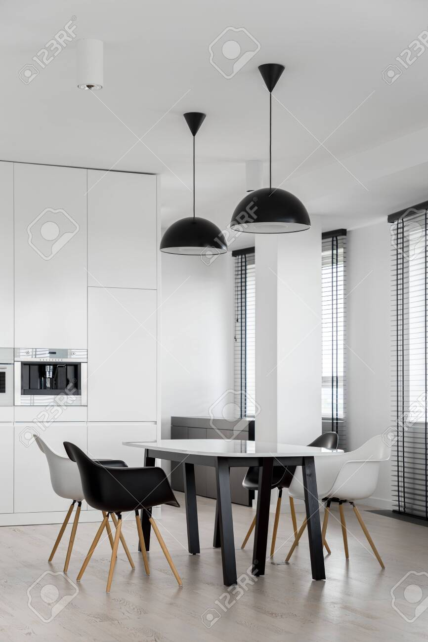 Stylish Dining Area With Modern Table And Chairs In Kitchen With Stock Photo Picture And Royalty Free Image Image 150061723