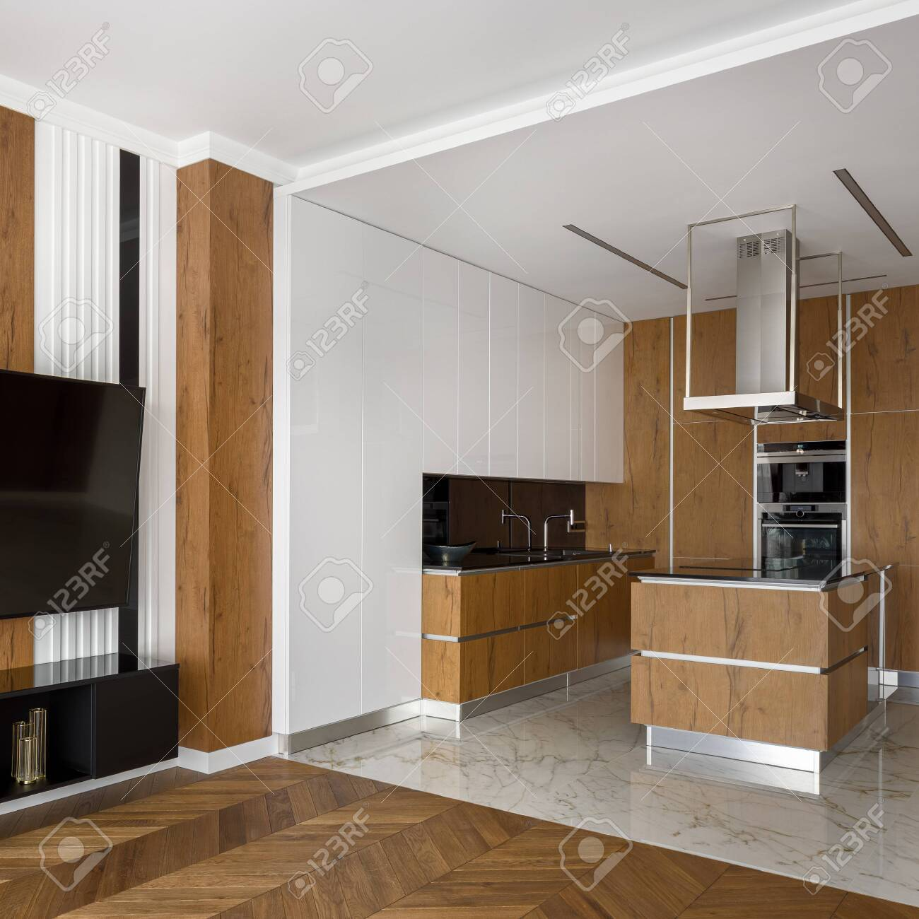 Elegant Kitchen In White And Wood And Marble Floor Open To Living Room With Big Television And Wooden Floor Fotos Retratos Imagenes Y Fotografia De Archivo Libres De Derecho Image 151987460