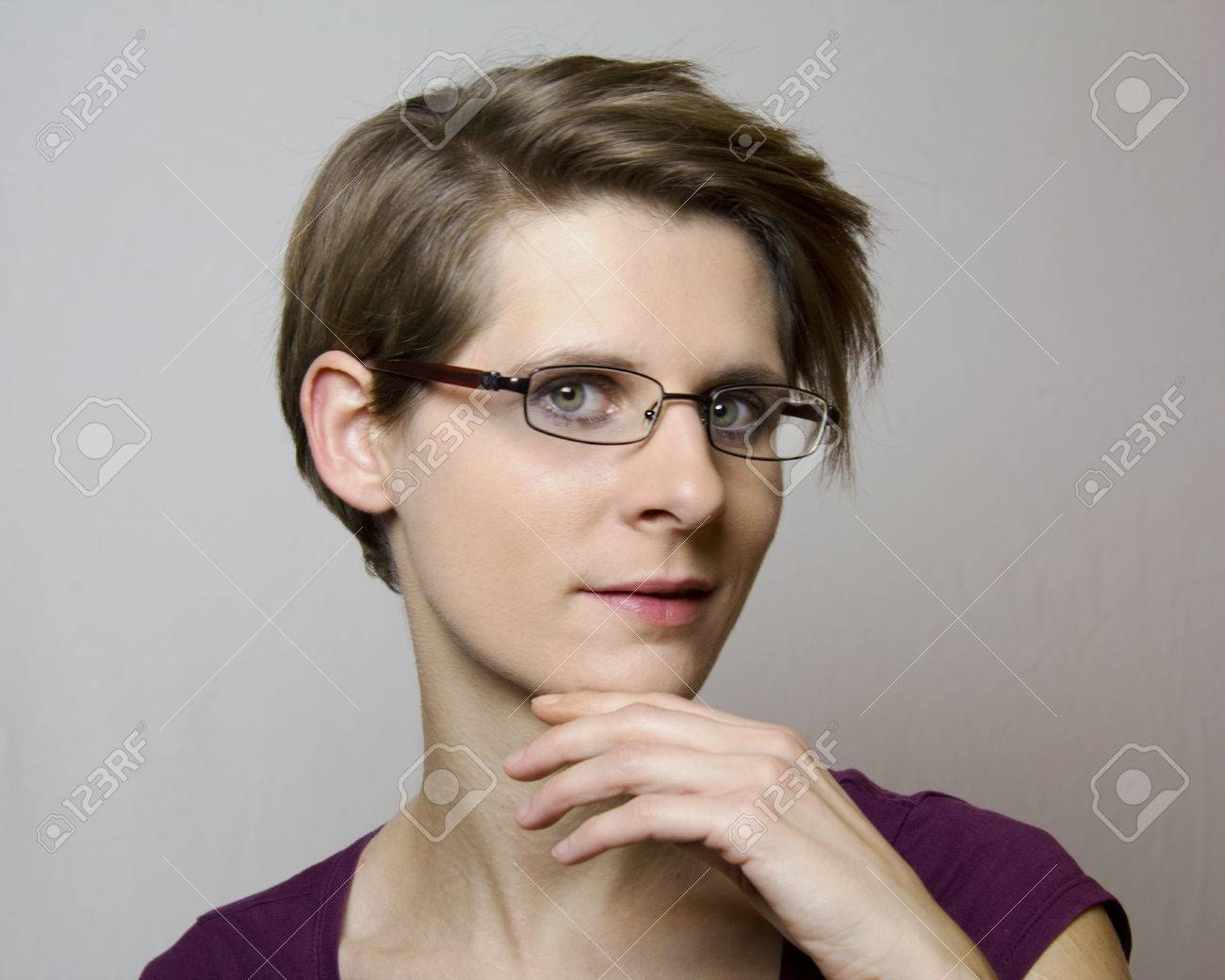 Portrait Of A Young Woman With Short Hair And Glasses