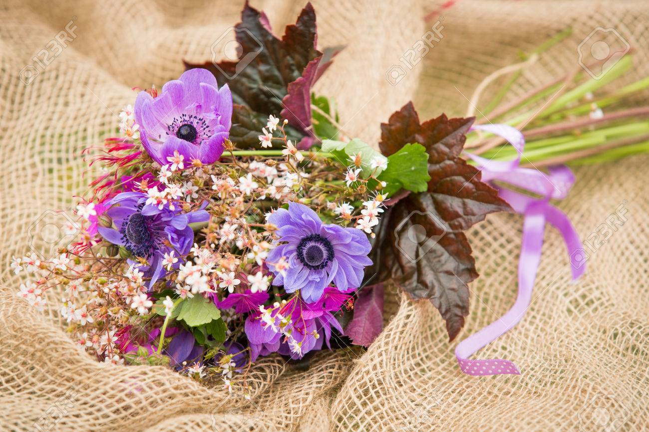 Garden style summer bouquet mix of lilac and purple anemone stock garden style summer bouquet mix of lilac and purple anemone flowers geranium flowers and izmirmasajfo